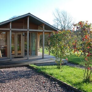 Front view of a luxury lodge at Three Choirs Vineyards